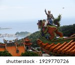 A Buddhistic Statue In The Top...