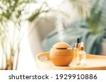 Aroma Oil Diffuser On Table In...