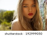 Beautiful Blonde Female With...