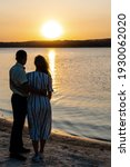 Couple Standing On The Sunset...