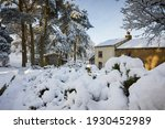 A Snowy View Of A Traditional...