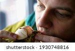 man eating italian bruschetta... | Shutterstock . vector #1930748816