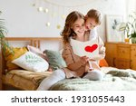 Cheerful Mother Hugging Son And ...