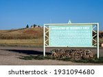 Small photo of Wounded Knee, USA - 09 22 1998: Wounded Knee burial mound overlooking the battlefield