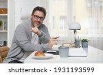 Happy Older Man Working Online...