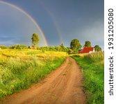 Rainbow Over Stormy Sky. Rural...