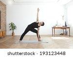 korean man doing yoga   Shutterstock . vector #193123448