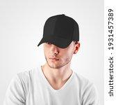 mockup of a black baseball cap... | Shutterstock . vector #1931457389