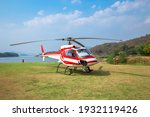 The Front Of The Red Helicopter ...
