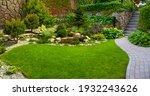 garden stone path with grass... | Shutterstock . vector #1932243626