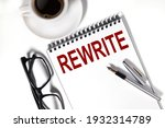Small photo of rewrite. Text on white notepad paper on light background