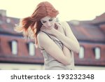beautiful woman with red hair  | Shutterstock . vector #193232348