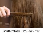 Comb your hair. young woman...