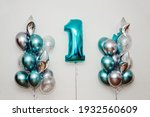 Small photo of Party balloons, birthday balloons, number one balloon, one year birthday celebration, turquoise white silver balloons