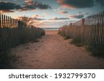 Sandy walkway down to the beach and ocean during a beautiful sunrise