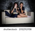 two girls looks tv at dark room | Shutterstock . vector #193291958