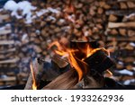 Burning Firewood With Stacked...