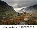 A single small red cabin...