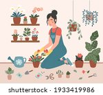 A Woman Is Planting Flowers In...