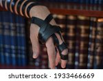 Small photo of Tefillin (phylactery) on arm for prayer