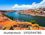 Douro river and local houses with orange roofs in Porto city aerial panoramic view. Porto is the second largest city in Portugal.