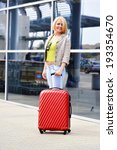 young woman with luggage at the ... | Shutterstock . vector #193354670