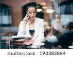 young businesswoman talking on... | Shutterstock . vector #193383884