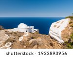 The church of Panagia Pantohara on the rocky north coast of the Greek island of Sikinos in the Cyclades archipelago
