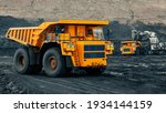 Small photo of A large quarry dump truck in a coal mine. Loading coal into body work truck. Mining equipment for the transportation of minerals.