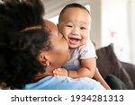 happy african american mother... | Shutterstock . vector #1934281313