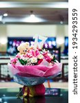 Small photo of sweet seventeenth hand bouquets close up, colorful flower with teddy bear doll and number 17th. blur background