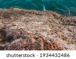 Turquoise Sea Wave Breaks On...