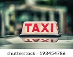 Red Taxi Sign.