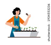 the girl is planting seeds for... | Shutterstock .eps vector #1934553236