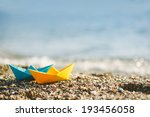 Blue And Yellow Paper Boats On...