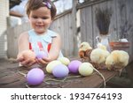 Little Girls Holding Chick In...