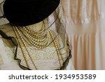 A Black Hat With A Veil Close...