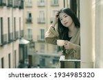 Asian Woman In Balcony Thinking ...
