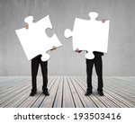 businessmen holding two puzzles ... | Shutterstock . vector #193503416