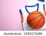 Basketball uniform and ball on...