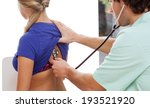 female patient during check up... | Shutterstock . vector #193521920