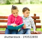 little boy and girl is reading... | Shutterstock . vector #193522850