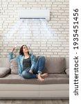 woman using conditioner in room.... | Shutterstock . vector #1935451456