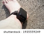 Small photo of House arrest GPS jail monitoring bracelet on male ankle due to jail sentence.