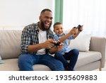 Joyful African Father And Kid...