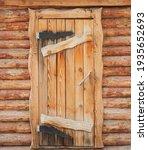 Wooden Front Door To A Rustic...