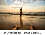 Woman Silhouette On The Beach...