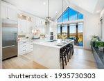 Small photo of bright, spacious and modern farmhouse style kitchen