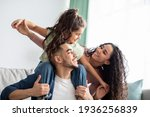 Cheerful Middle Eastern Family Of Three Having Fun Together At Home