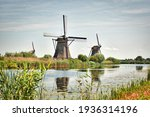 Windmills By Canal In The...